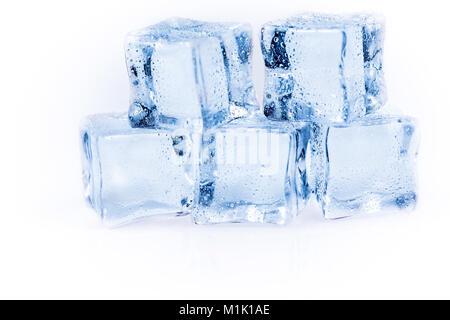 Many ice cubes on white reflection background - Stock Photo