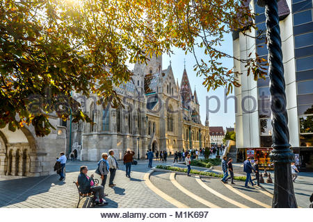 Afternoon at the Budapest Hungary Castle District standing outside the Fisherman's Bastion with Saint Matthias Church - Stock Photo