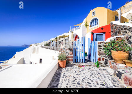 Oia, Santorini - Greece. Famous attraction of white village with cobbled streets and colored houses, Greek Cyclades - Stock Photo