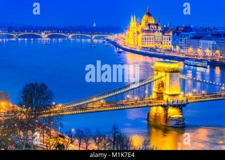 Budapest, Hungary. Szechenyi Chain Bridge and Hungarian Parliament Building over Danube River. - Stock Photo