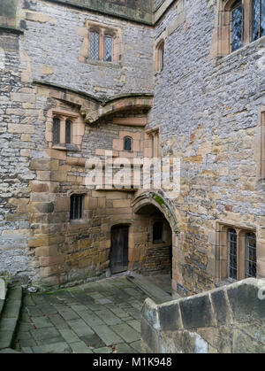 The visitor entrance to Haddon Hall as seen from the inner courtyard; it's a medieval manor house in Derbyshire, - Stock Photo