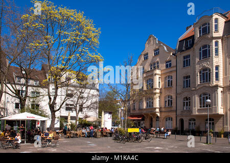 Germany, Cologne, pavement cafes on the Schill square in the district Nippes.  Deutschland, Koeln, Strassencafes - Stock Photo