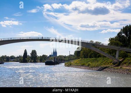 Germany, Cologne, pedestrian bridge at the harbor in the district Muelheim, in the background the cathedral.  Deutschland, - Stock Photo