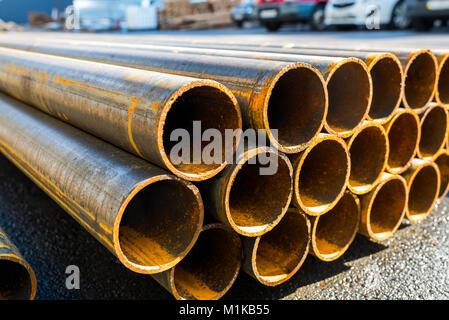 round metal rolled metal tubes - Stock Photo