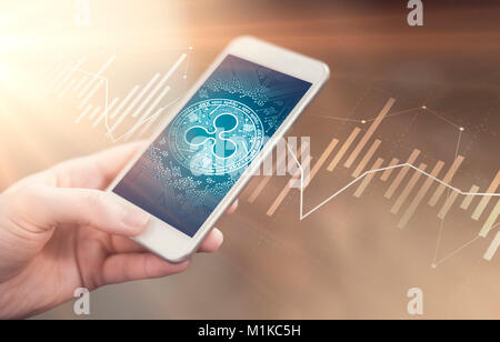 Ripple coin symbol on mobile app screen. Ripple price grows or falls. New digital money. - Stock Photo