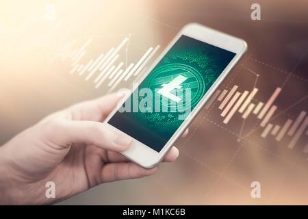 Litecoin symbol on mobile app screen. Litecoin price grows or falls. New digital money. - Stock Photo