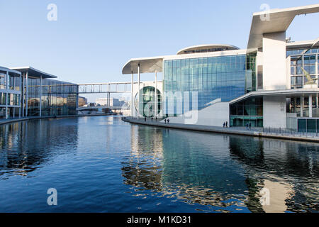 Berlin modern architecture of German Federal Government and Chancellery building located by the River Spree. Blue - Stock Photo