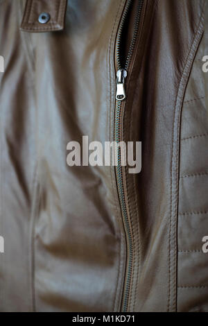 Closeup of a leather texture with a zipper, shallow depth of field - Stock Photo