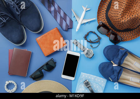 Flat lay image of accessory clothing man or women to plan travel in holiday background concept.Mobile phone & passport - Stock Photo