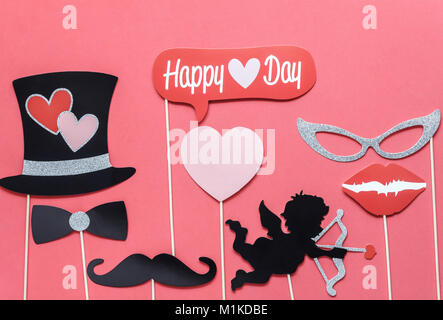Flat lay aerial image of sign of valentines 's day background concept.DIY photo booth props the cupid shoot arrow - Stock Photo