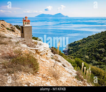 Remote roadside shrine in the form of a Greek church on the island of Ithaka in the Ionian Islands - Stock Photo