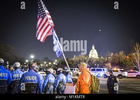 Washington, DC, USA. 30th Jan, 2018. Activists run a protest evening Tuesday, State of the Union events against - Stock Photo
