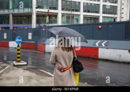 London, UK. 31st Jan, 2018. UK Weather. People rush to try and avoid the heavy downpours of rain in Victoria London - Stock Photo