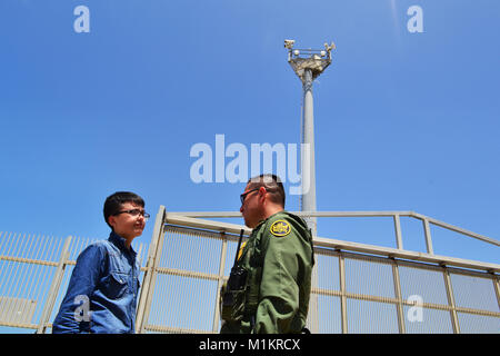 August 13, 2017 - San Diego, California, United States - A visitor seen talking to a Border Patrol agent in Friendship - Stock Photo