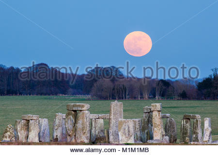 Stonehenge, UK. 31st Jan, 2018. Super Blue Blood Moon is seen rising over Stonehenge stone circle on Wednesday, - Stock Photo