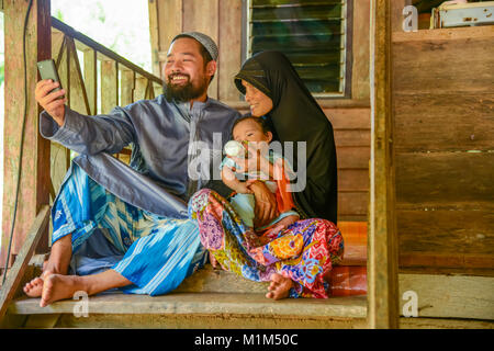 KRABI, THAILAND - MAY 2, 2015: Lovely Muslim family selfie themselves. in home in Lanta island of Krabi, Thailand - Stock Photo