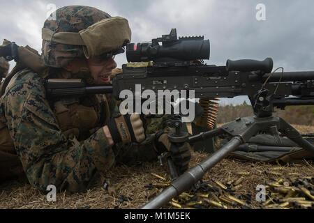 Private First Class Nicolas Kurtz, a Marine with 1st Battalion, 2nd Marine Regiment, 2nd Marine Division, fires - Stock Photo