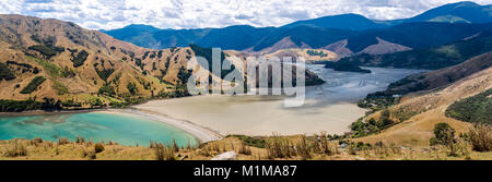 Elevated panoramic view of Golden Bay, Nelson, New Zealand with turquoise sea meeting sandy beach and mountains - Stock Photo