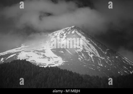 Black and white high contrasted landscape of Todorka peak, Pirin mountain, Bansko ski resort in Bulgaria - Stock Photo