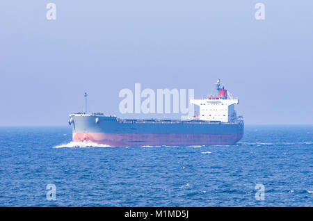 A cargo ship, the bulk carrier LILY ATLANTIC is in the process of crossing the route of another ship. - Stock Photo