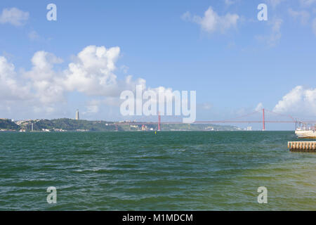 Ponte 25 de Abril suspension bridge in the distance crossing the river Tagus, Lisbon, Portugal - Stock Photo