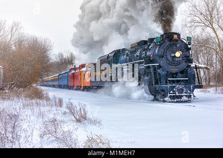 "The Pere Marquette 1225 ""North Pole Express"" steams along snowy track on a winter day. - Stock Photo"