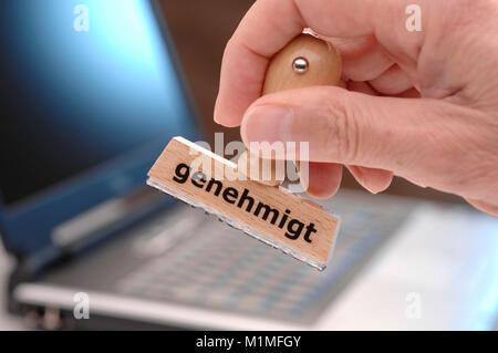 Stempel mit Aufdruck genehmigt als Büroutensil - Stock Photo