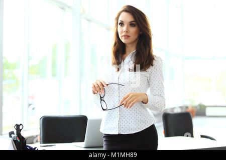 Modern business woman in the office with copy space. - Stock Photo