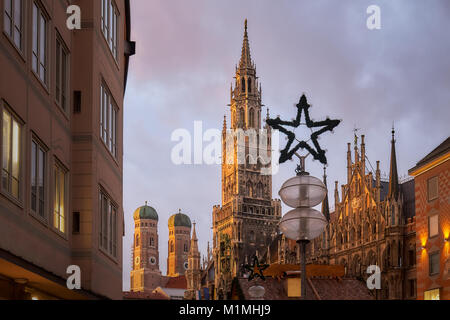 Marienplatz square in Munich with New Town Hall (Rathaus) and The Frauenkirche church in frame - Stock Photo