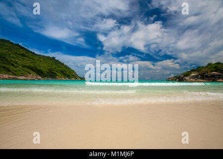 The beautiful dreamlike beach of Siam Bay, flanked by hills, on Ko Racha Yai. Racha Island is off the southeastern - Stock Photo