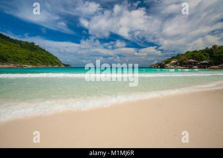 The empty paradise-like beach of Siam Bay, flanked by hills, on Ko Racha Yai. Racha Island is off the southeastern - Stock Photo