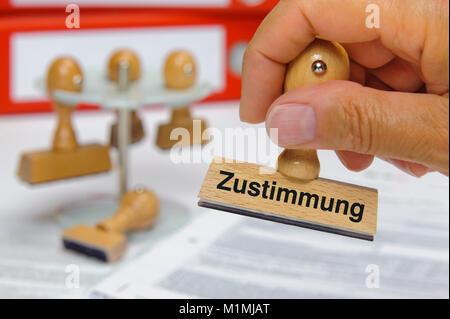 Stempel in Hand beschriftet mit Zustimmung - Stock Photo