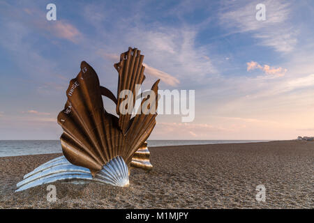 Scallop Shell Sculpture at Sunset with beautiful pink sky on Aldeburgh Beach in Suffolk, England - Stock Photo