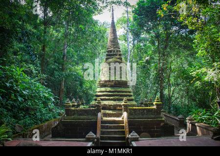 Alongkorn Chedi Pagoda located in rainforest of Namtok Phlio National Park near Phlio Waterfall at Chanthaburi Province, - Stock Photo