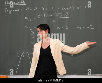 School Teacher gives lessons MR, Schule - Lehrerin gibt Unterricht MR - Stock Photo