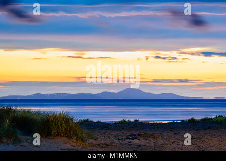Barmouth seafront looking north across Cardigan Bay towards Pwllheli. - Stock Photo