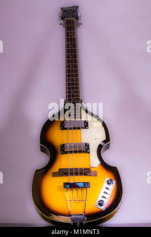 Beatles / Beatle violin bass guitar. Original models of this iconic shape instrument were introduced in the 1950s, - Stock Photo
