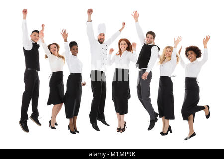 Restaurant Staff Celebrating Their Success Over White Background - Stock Photo