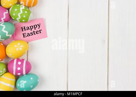 Happy easter gift tag with colorful easter egg double border against happy easter gift tag with colorful easter egg side border against a white wood background negle Image collections