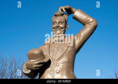 Memorial statue of Stan Laurel in Dockwray square (Laurel Park), North Shields, north east England, UK - Stock Photo