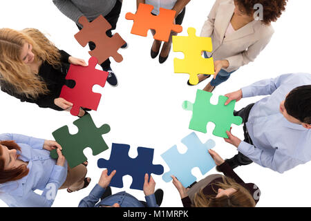 Students solving jigsaw puzzle as a team in university ...