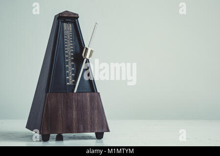 Color shot of a vintage metronome - Stock Photo