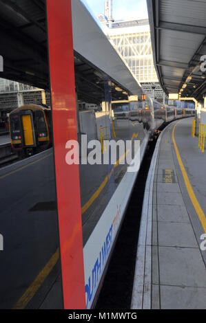 trains in platforms at the London terminal railway station at waterloo. mainline commuting commuter stations in - Stock Photo