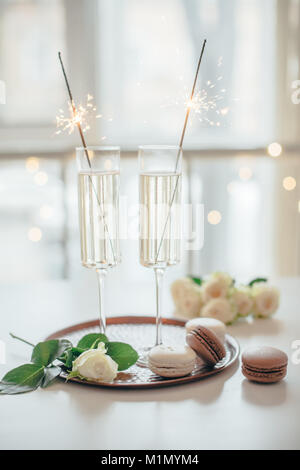 Luxurious champagne wedding party with white roses and macaron d - Stock Photo