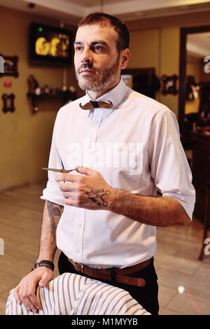 stylish barber man getting ready to work - Stock Photo