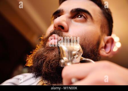 Shaving your beard in barbershop - Stock Photo