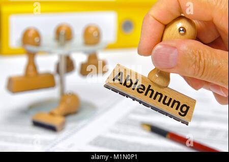 Stempel in Hand beschriftet mit Ablehnung - Stock Photo