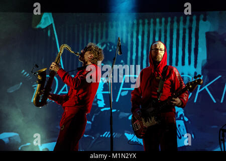 The red jumpsuit-wearing Norwegian electronic rock band Datarock is here seen doing a sound check before a live - Stock Photo