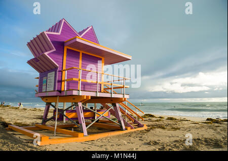 Scenic morning view of an iconic colorful lifeguard tower on South Beach, Miami - Stock Photo