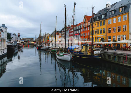 Nyhavn harbor in Copenhagen, Denmark - September, 22th, 2015. Most attractive and full of tourist place in the city. - Stock Photo